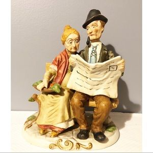 Large Statue of Elderly Couple On A Bench